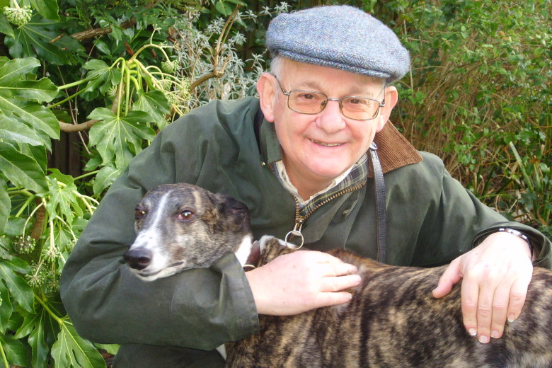 Lord David Lipsey and brindle greyhound